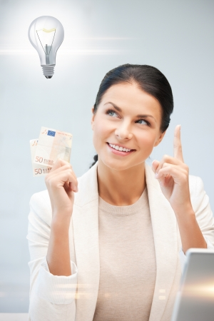 happy woman with cash euro money and light bulb Stock Photo - 18655021