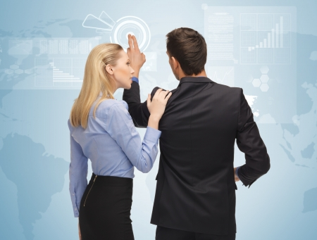telecommute: picture of man and woman working with virtual screen Stock Photo