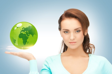 picture of woman holding green globe on her hand photo