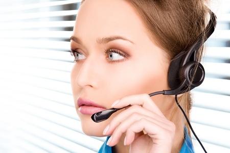 bright picture of friendly female helpline operator Stock Photo - 18655075