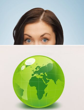 greenhouse effect: young woman with illustration of green eco globe