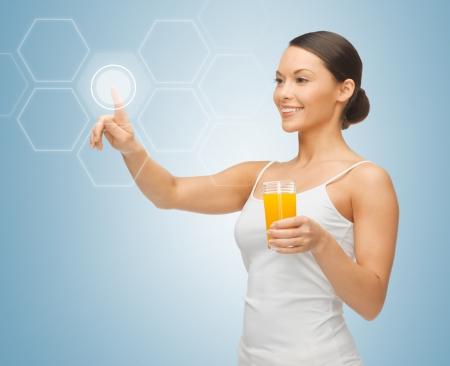 projection: woman holding glass of juice and working with virtual screen