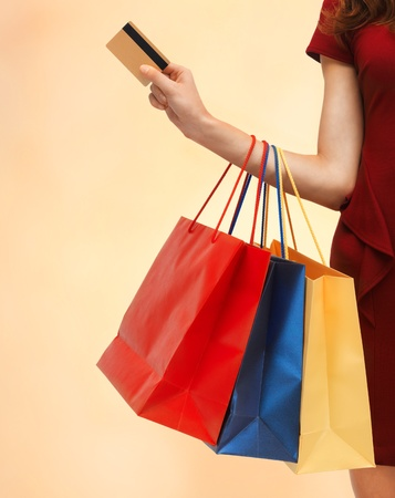 credit card bills: closeup or picture of woman with shopping bags   Stock Photo