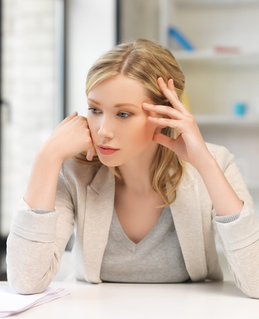 indoor picture of bored and tired woman behind the table Stock Photo - 18655097