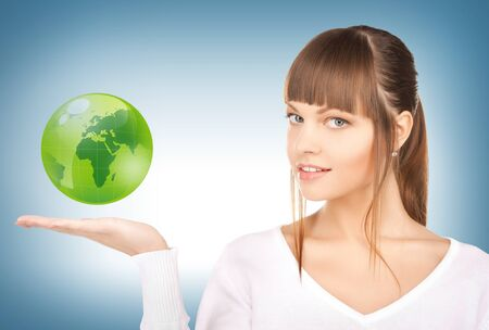 international recycle symbol: picture of woman holding green globe on her hand
