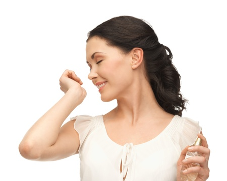 perfume bottle: picture of beautiful woman smelling perfume on her hand