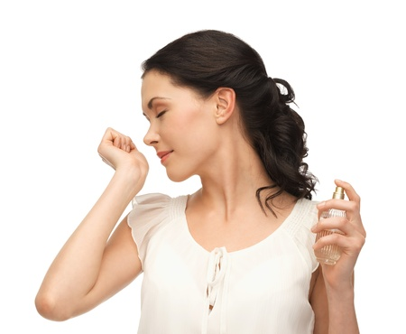 perfume woman: picture of beautiful woman smelling perfume on her hand