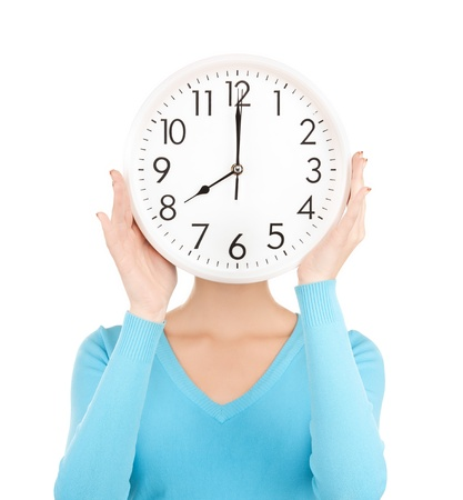 working late: picture of businesswoman with clock over her face