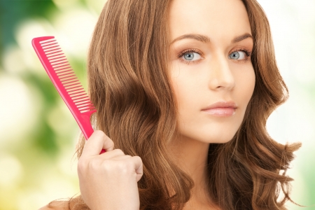 combing: bright picture of beautiful woman with comb