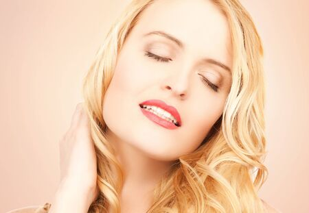 long neck: face of beautiful woman with long blonde hair