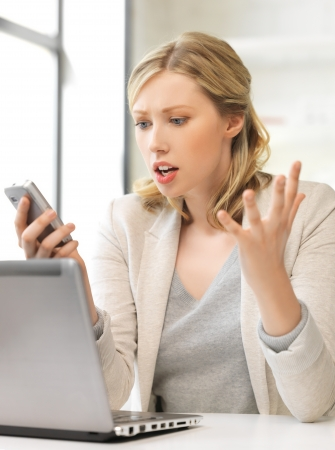confused woman: picture of confused woman with cell phone Stock Photo