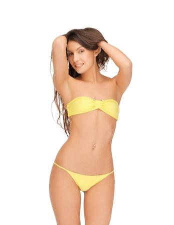 picture of beautiful woman in bikini playing with hair photo