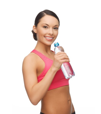 stamina: picture of sporty woman drinking water from bottle