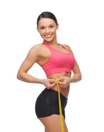 beautiful sporty woman with measuring tape Stock Photo