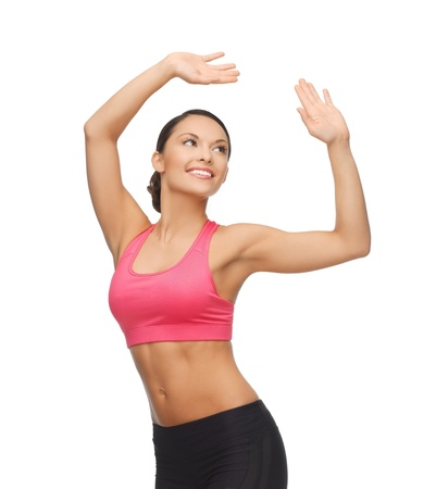 moves: beautiful sporty woman in aerobic or dance movement