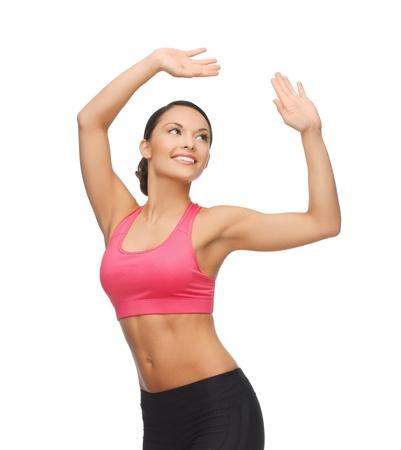 zumba: beautiful sporty woman in aerobic or dance movement