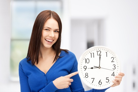 woman with clock: bright picture of woman holding big clock