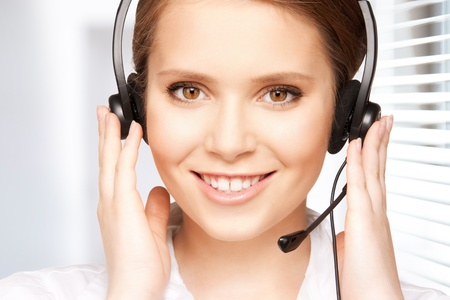 bright picture of friendly female helpline operator Stock Photo - 18822408