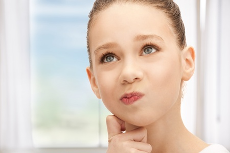 bright closeup picture of pensive teenage girl Stock Photo - 18803804