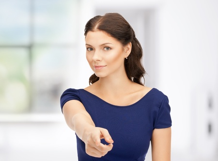 picture of attractive businesswoman pointing her finger Stock Photo - 18803815