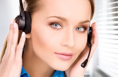 bright picture of friendly female helpline operator Stock Photo - 18803786