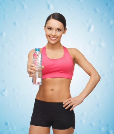 athletic wear: picture of sporty woman with bottle of water Stock Photo
