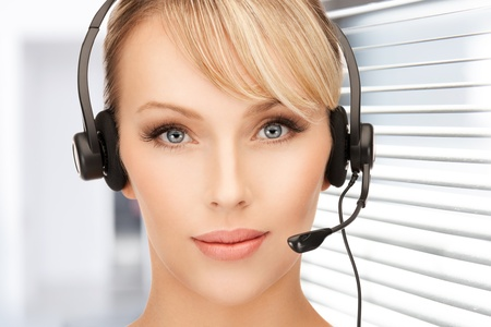 bright picture of friendly female helpline operator Stock Photo - 18803809