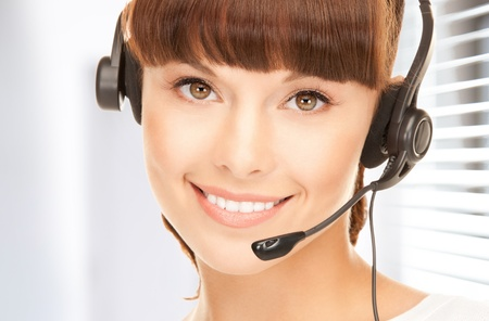 bright picture of friendly female helpline operator Stock Photo - 18803859
