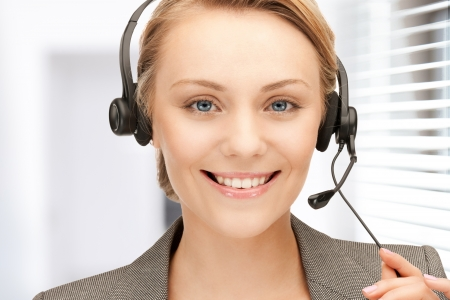 bright picture of friendly female helpline operator Stock Photo - 18803833