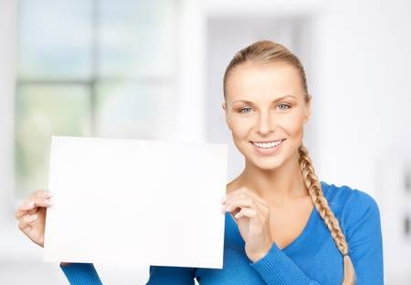bright picture of confident woman with blank board Stock Photo - 18822398