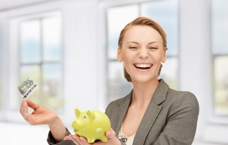 picture of lovely woman with piggy bank and money Stock Photo - 18822409
