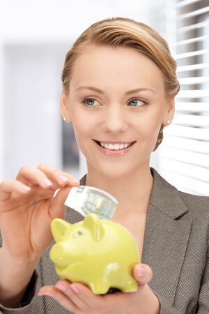 picture of lovely woman with piggy bank and money Stock Photo - 18803798