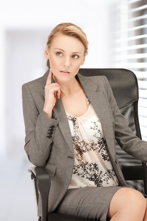 bright studio picture of beautiful pensive woman Stock Photo - 18803795