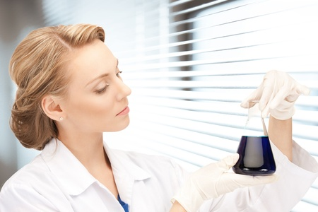 picture of beautiful lab worker holding up test tube Stock Photo - 18822406