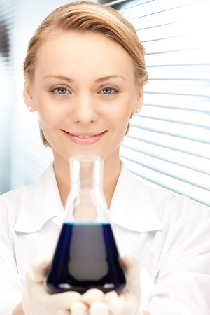 picture of beautiful lab worker holding up test tube Stock Photo - 18822407