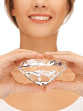 valuable: close-up of woman s hands showing big diamond Stock Photo