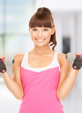 lovely fitness instructor with dumbbells in gym Stock Photo - 18822389