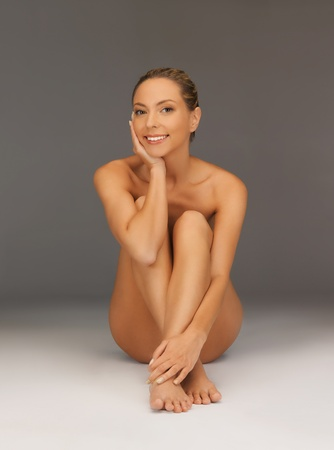 picture of healthy naked woman sitting on the floor Stock Photo - 18803851