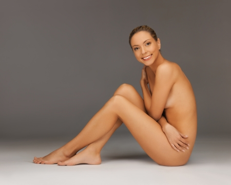 picture of healthy naked woman sitting on the floor Stock Photo - 18803813