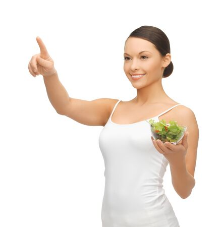 woman with salad pointing her finger at something Stock Photo - 18822380
