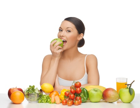 woman eating apple with lot of fruits and vegetables Stock Photo - 18822385