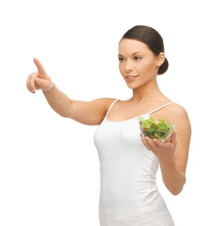 woman with salad pointing her finger at something Stock Photo - 18822381