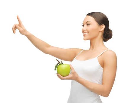 woman with green apple pointing her finger at something  Stock Photo - 18822378