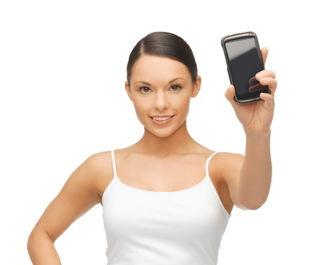 beautiful sporty woman showing smartphone with app Stock Photo - 18822383