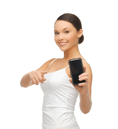 beautiful sporty woman showing smartphone with app photo
