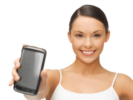 beautiful sporty woman showing smartphone with app Stock Photo - 18822396
