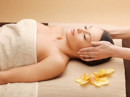 spa towels: picture of woman in spa salon lying on the massage desk