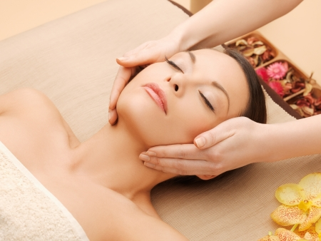 beauty parlor: woman in spa salon lying on the massage desk