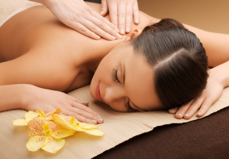 therapeutic massage: picture of woman in spa salon lying on the massage desk