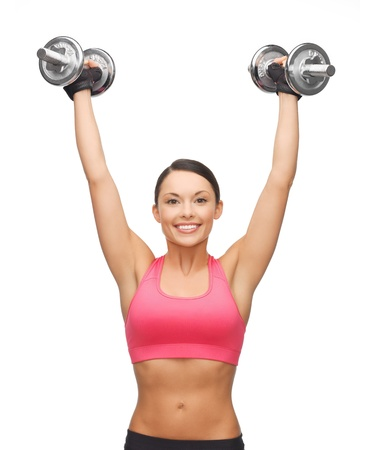 picture of young sporty woman with heavy steel dumbbells Stock Photo - 18822384